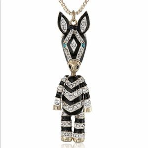 Betsey Johnson• long zebra pendant necklace
